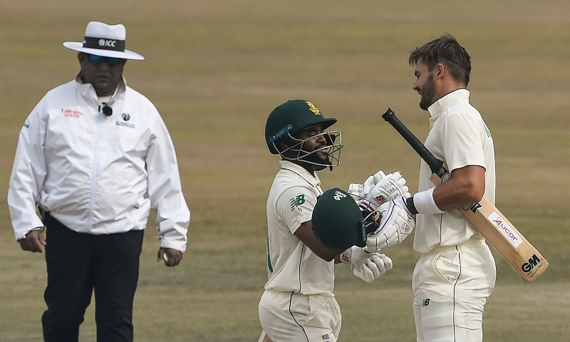 South Africa's Aiden Markram (R) celebrates with teammate Temba Bavuma (C) after scoring a century (100 runs) during the fifth and final day of the second Test cricket match at the Rawalpindi Cricket Stadium on Feb 8. —  AFP