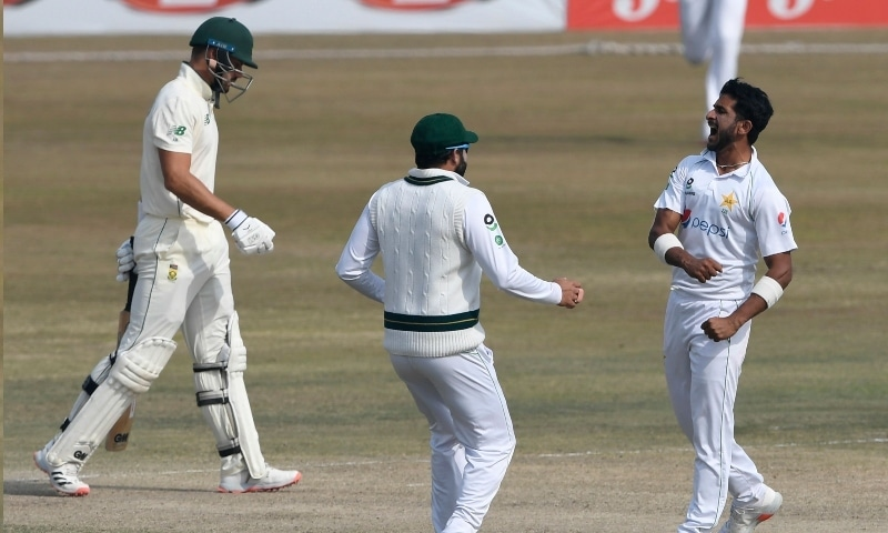 Pakistan's Hasan Ali (R) celebrates after taking the wicket of South Africa's Aiden Markram (L) during the fifth and final day of the second Test cricket match at the Rawalpindi Cricket Stadium on Feb 8. —  AFP