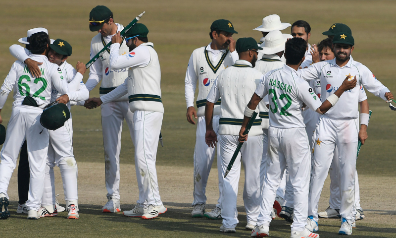 Pakistan's players celebrate after winning the Test series against South Africa during the fifth and final day of the second Test cricket match between Pakistan and South Africa at the Rawalpindi Cricket Stadium in Rawalpindi on Monday. — AFP