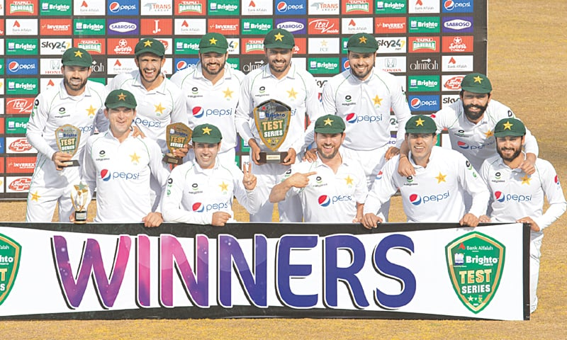 RAWALPINDI: Pakistan players pose with the series trophy after the second Test against South Africa at the Pindi Cricket Stadium on Monday.—Tanveer Shahzad/White Star