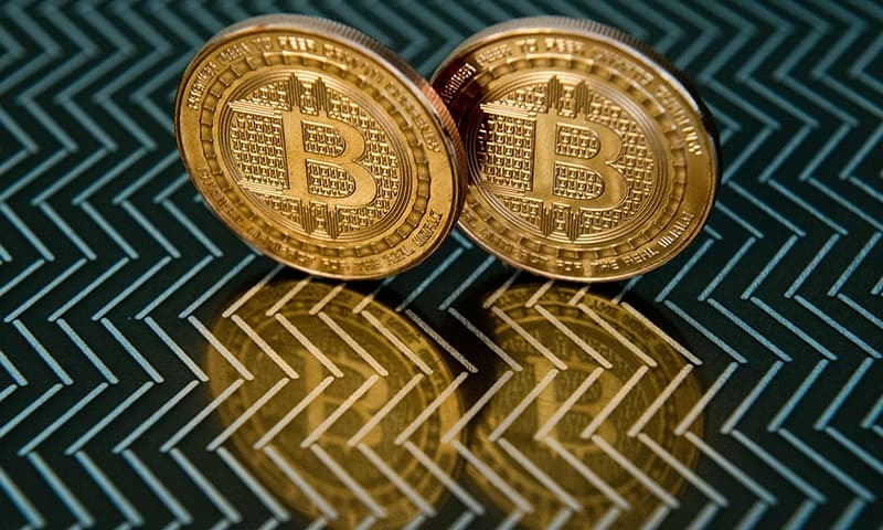 This June 17, 2014 photo taken in Washington, DC shows bitcoin medals. —AFP/File