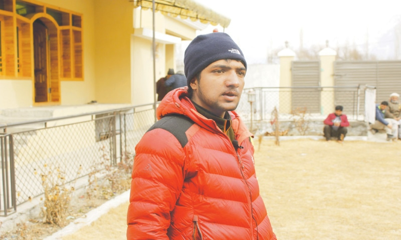 Skardu: Sajid Ali Sadpara, son of missing mountain climber Ali Sadpara, talks to local journalists at his house. Sajid had begun to climb K2, but was forced to abandon the summit attempt after his equipment failed.—AP