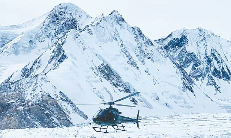 A Pakistan Army helicopter carries out search for missing climbers near K2 on Saturday. — Dawn/File