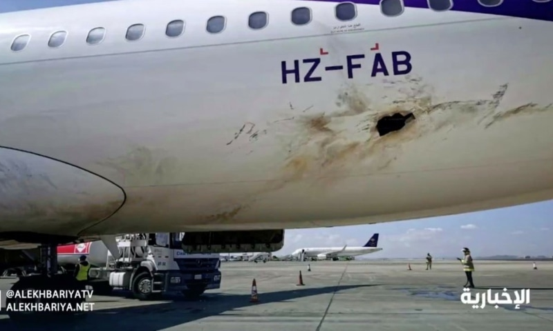 In this frame grab from video, Saudi state television shows an airplane damaged in an attack by Yemen's Houthi rebels at an airport near Abha, Saudi Arabia, Wednesday. — Saudi state television via AP