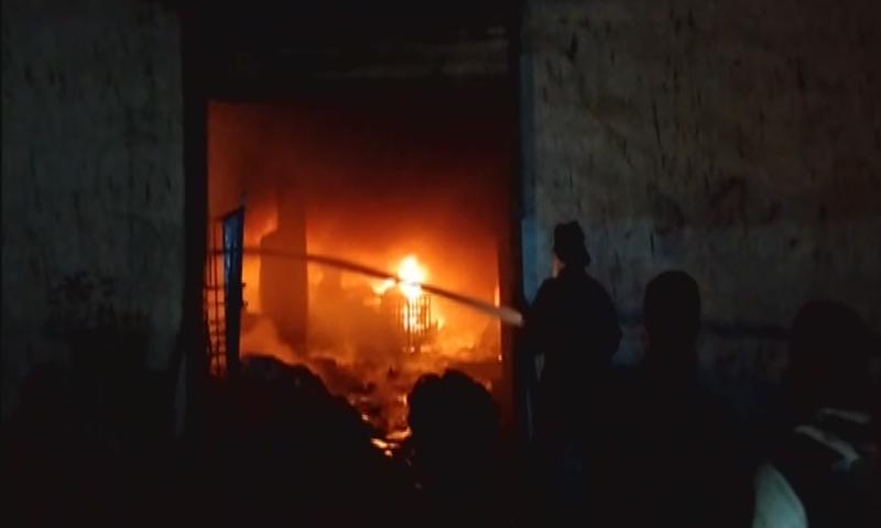 Firemen work to extinguish the blaze at the factory in Baldia Town. —DawnNewsTV