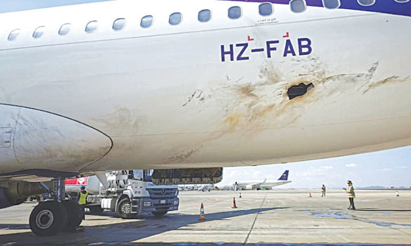 THIS handout picture taken on Wednesday and released by Saudi Arabia's media ministry shows the damaged hull of an airliner parked on the tarmac of Abha International Airport in the kingdom's Asir province.—AFP