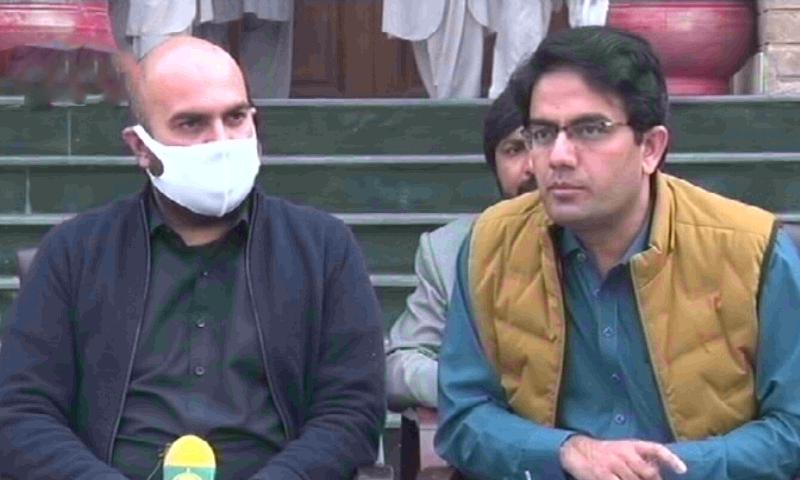 In this file photo, KP government spokesman Kamran Bangash (right) and provincial minister Taimur Jhagra address the media.— DawnNewsTV/File