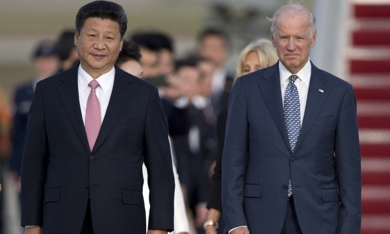 In this Sept 24, 2015, file photo, Chinese President Xi Jinping and then-US vice president Joe Biden walk down the red carpet on the tarmac during an arrival ceremony at Andrews Air Force Base. — AP