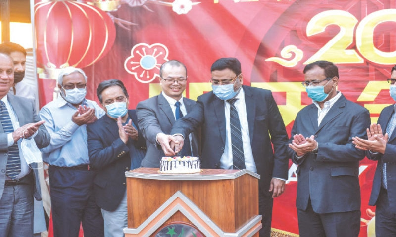 PARTICIPANTS of the ceremony cut a cake to mark the Chinese New Year.—White Star
