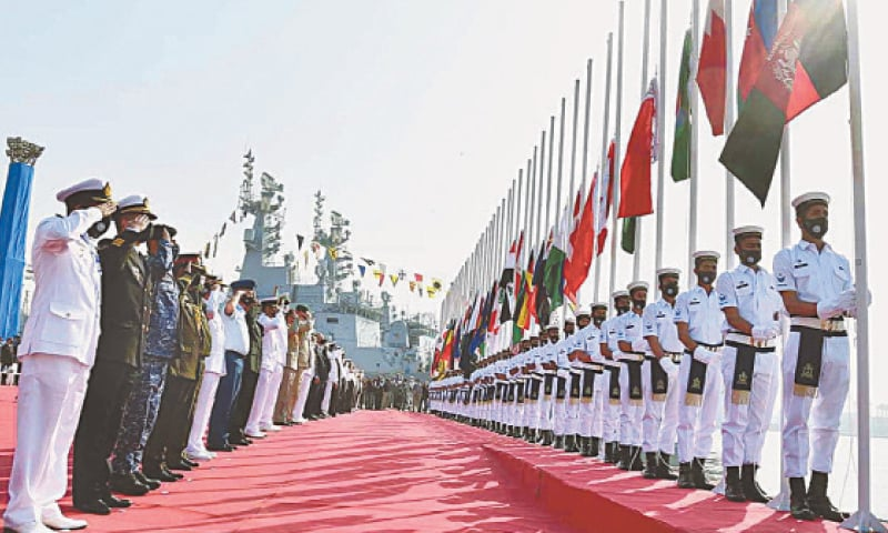 KARACHI: Navy officials present salute during the flag-hoisting ceremony of multinational naval exercise Aman-21 at the PN Dockyard on Friday. — APP