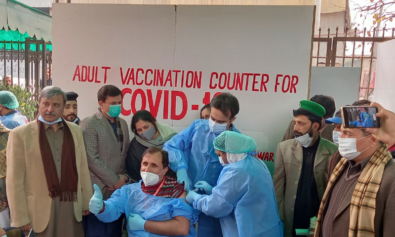 A dose of the Covid-19 vaccine is administered to a health worker in Peshawar. — Photo provided by Sirajuddin/File