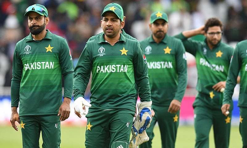 Former captain Sarfaraz Ahmed, team veteran Mohammad Hafeez and other cricketers leave the field at end of play during the 2019 Cricket World Cup group stage match between West Indies and Pakistan at Trent Bridge in Nottingham, central England on May 31, 2019. — AFP