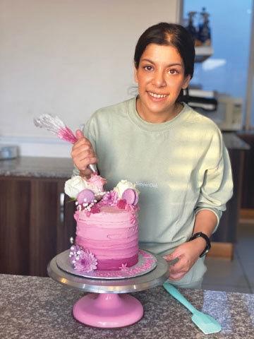 Eesha Hussain icing a cake