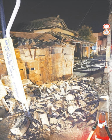 A house is damaged due to an earthquake in Koorimachi, Fukushima prefecture, northeastern Japan, early on Sunday.—AP