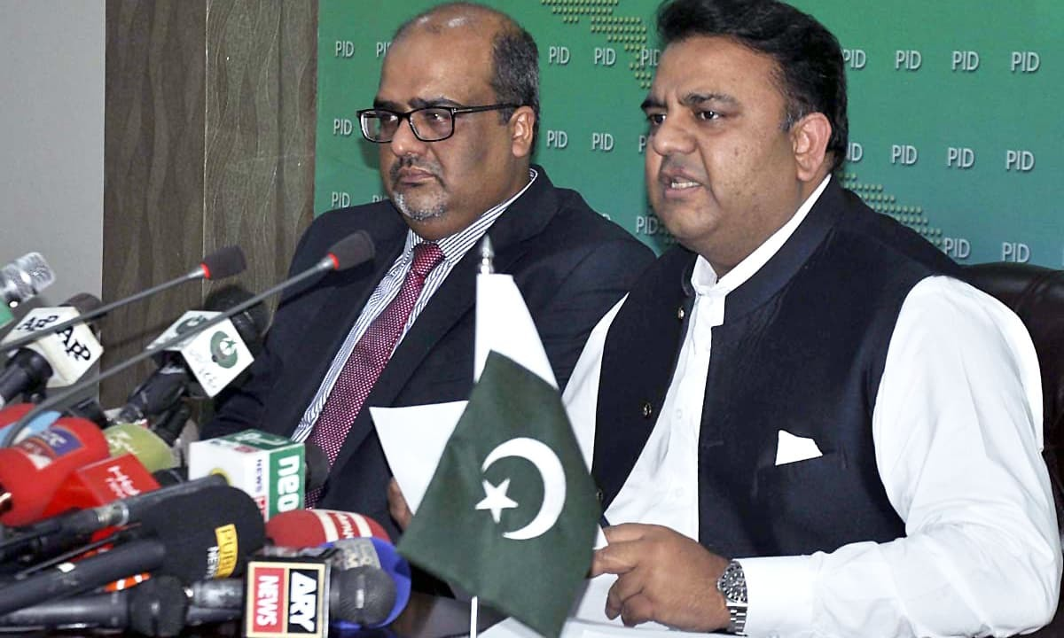 Minister for Science and Technology Fawad Chaudhry (R) is a member of the three-member ministerial committee. — APP/File