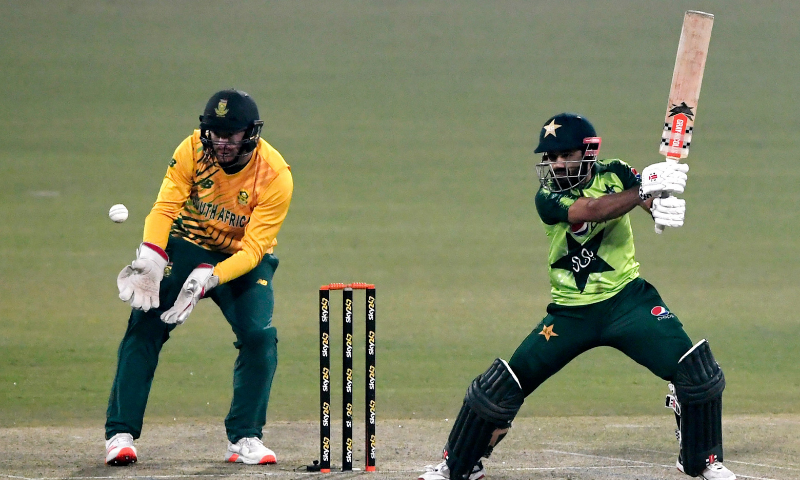 Mohammad Rizwan (R) plays a shot as South Africa's wicketkeeper captain Heinrich Klaasen watches during the third T20 international cricket match between Pakistan and South Africa on Sunday. — AFP