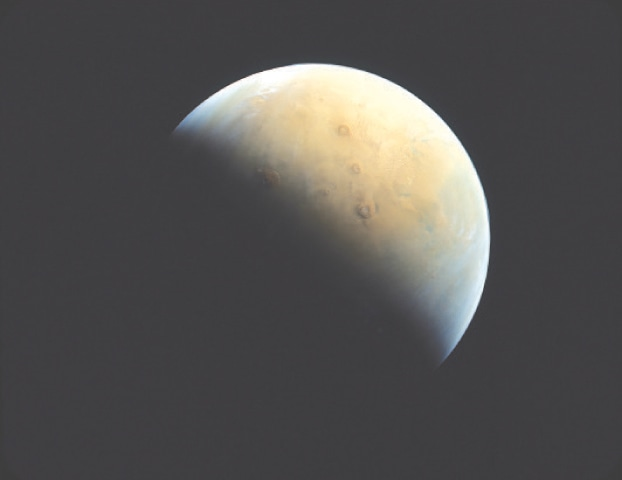 A HANDOUT picture taken after UAE's probe entered Nars orbit shows a view of the Red Planet.—Reuters