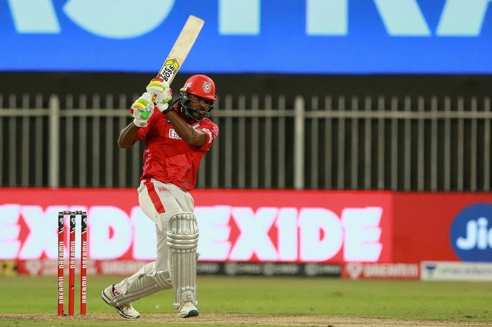 Chris Gayle swats one down the ground, Royal Challengers Bangalore vs Kings XI Punjab, IPL 2020, Sharjah, October 15, 2020. — Photo courtesy BCCI