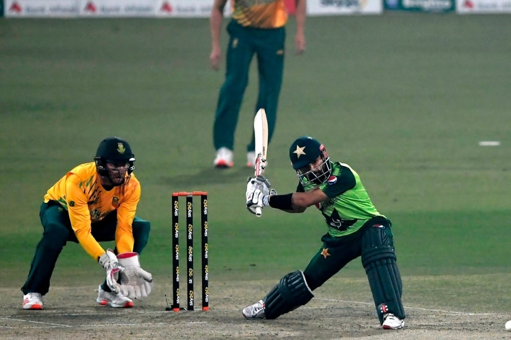 Mohammad Rizwan goes for a slog sweep, Pakistan vs South Africa, 2nd T20I, Lahore, February 13, 2021. — AFP