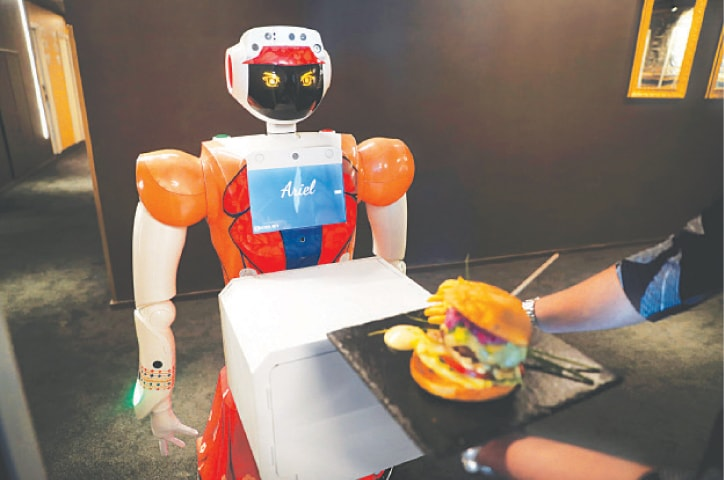 JOHANNESBURG: Ariel, a robot powered by artificial intelligence, delivers room service to a guest at Ski Hotel, the first in Africa to use automated attendants.—Reuters