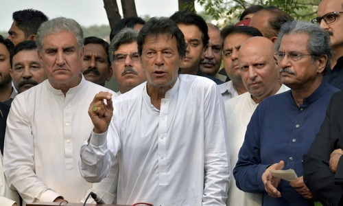 This file photo shows Prime Minister Imran Khan (middle), Foreign Minister Shah Mahmood Qureshi (left) and Education Minister Shafqat Mahmood.  — File