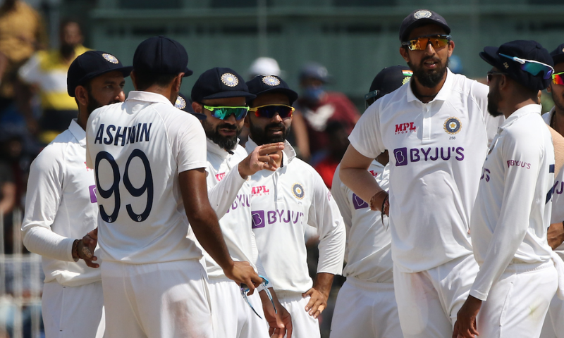 Indian skipper Virat Kohli (centre) gestures while talking to his teammates during the second Test against England in Chennai. — Photo courtesy ICC Twitter