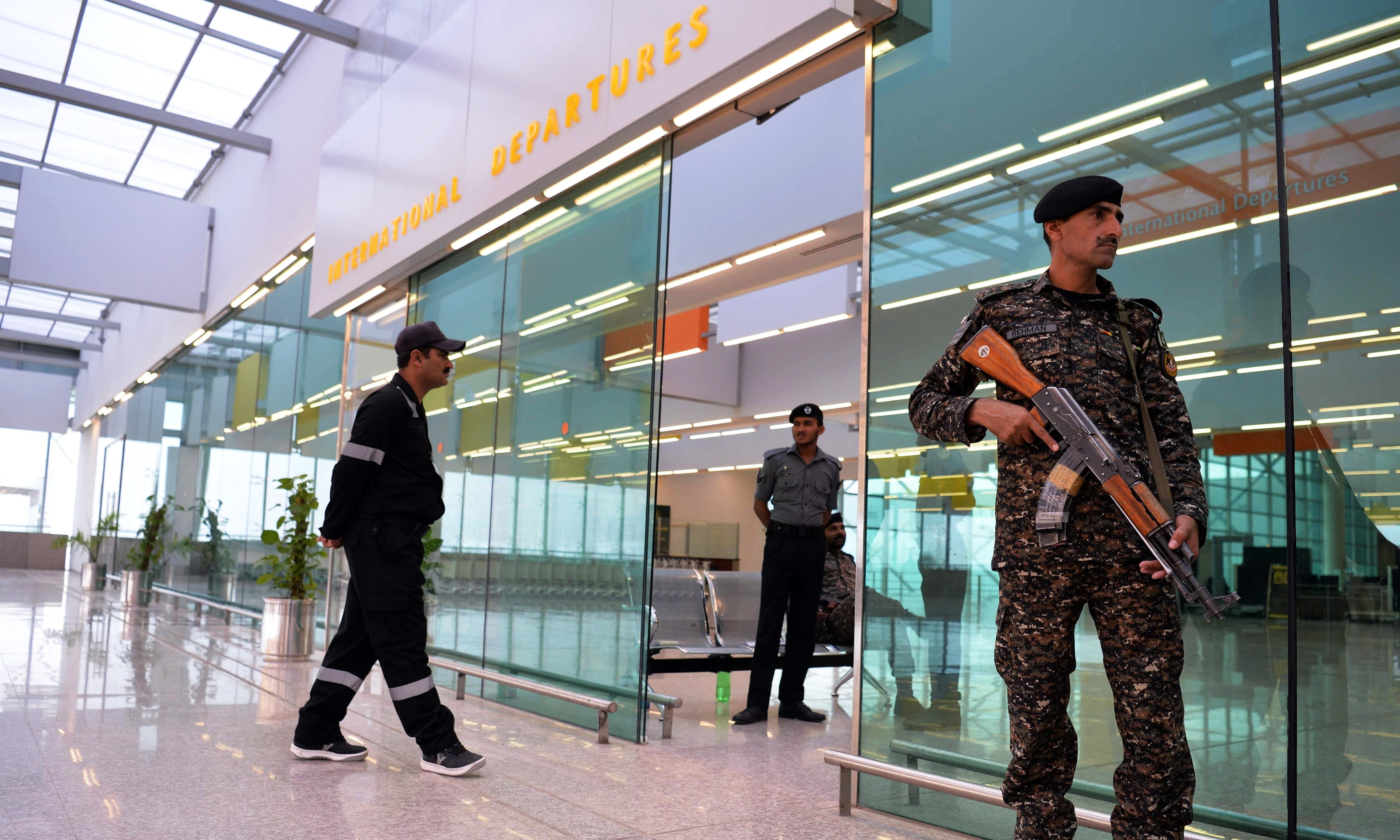 Pakistani security officials from the Airport Security Force (ASF) stand guard at the newly-built Islamabad International Airport ahead.  — AFP/File