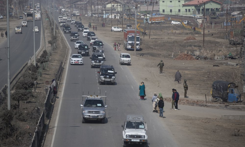 A motorcade of diplomats from various countries moves through in Srinagar, occupied Kashmir on Wednesday. — AP