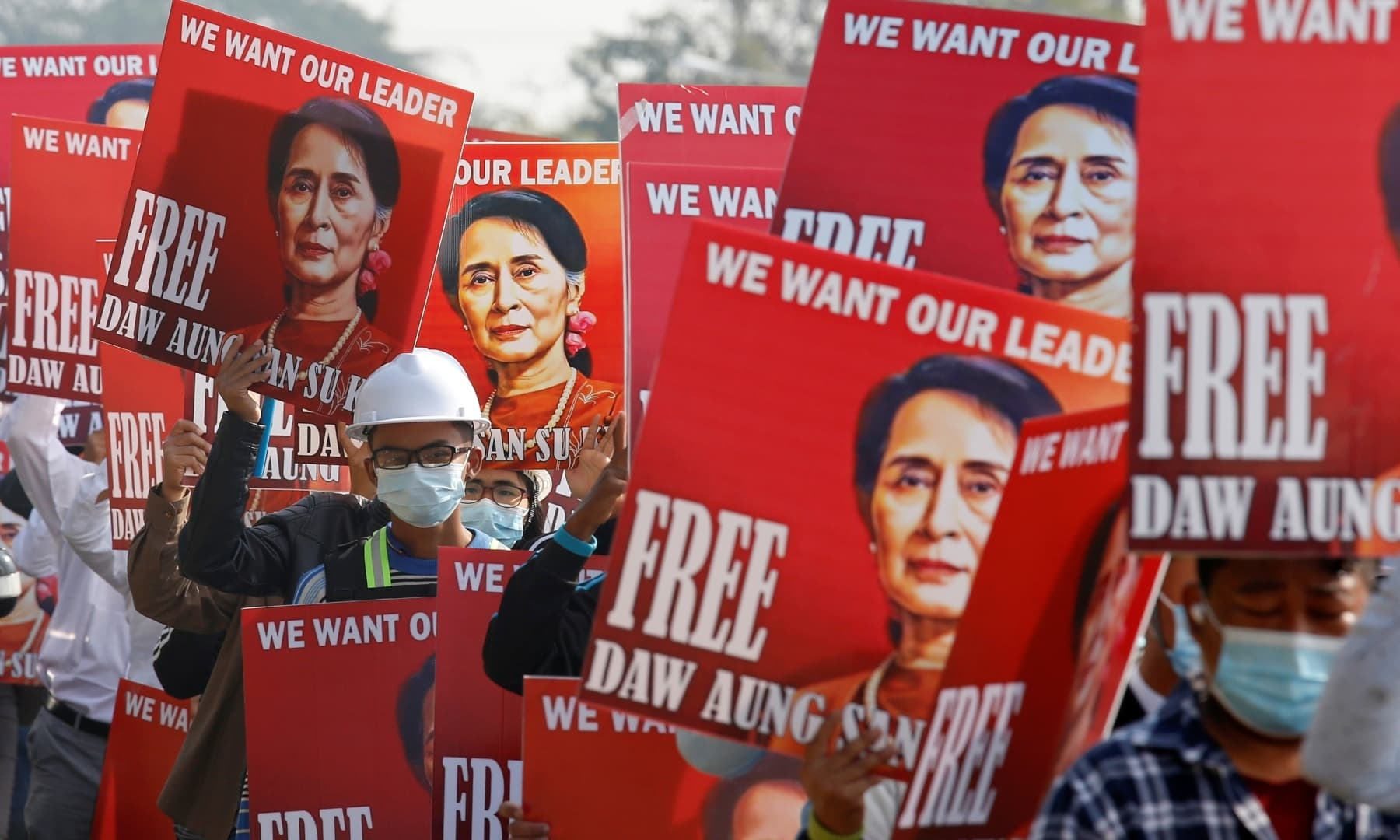 Demonstrators hold placards with the image of Aung San Suu Kyi during a protest against the military coup, in Naypyitaw, Myanmar. — Reuters