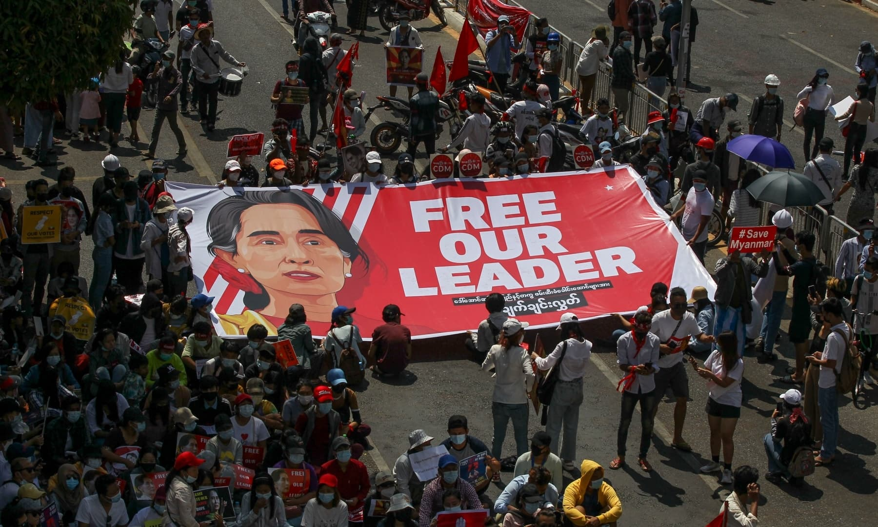 Demonstrators display a banner with an image of deposed Myanmar leader Aung San Suu Kyi during a protest against the military coup in Yangon, Myanmar, Wednesday. — AP