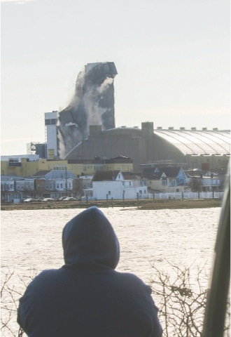 A MAN watches as the Trump Plaza hotel and casino implode.—AFP