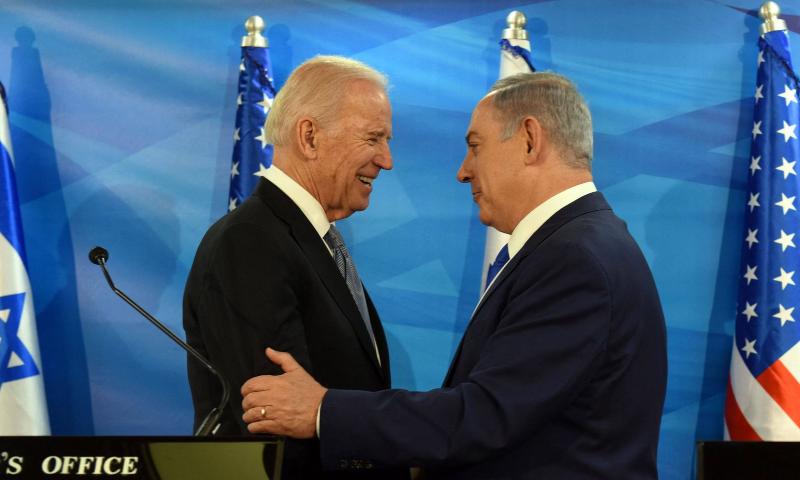 In this file photo taken on March 9, 2016, US Vice President Joe Biden and Israeli Prime Minister Benjamin Netanyahu shake hands while giving joint statements at the prime minister's office in Jerusalem. — AFP/File