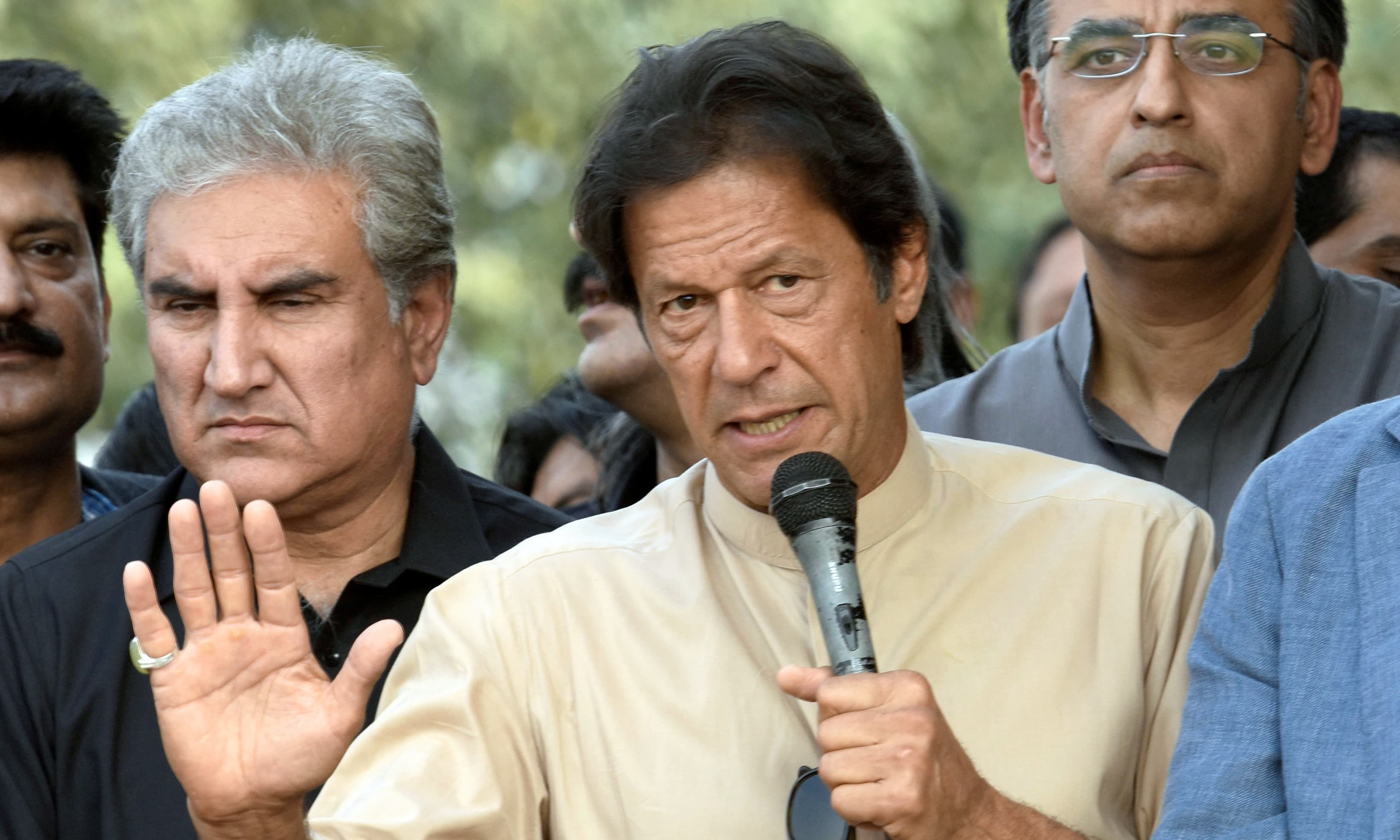 This file photo shows PTI chairman Imran Khan addresseing PTI workers outside Bani Gala. —Reuters/File