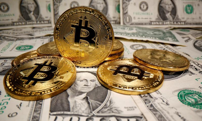 Representations of virtual currency Bitcoin are placed on US Dollar banknotes in this illustration. — Reuters/File