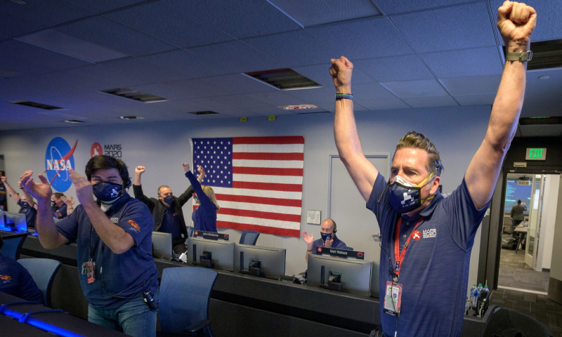 Members of Nasa's Perseverance rover team react in mission control after receiving confirmation the spacecraft successfully touched down on Mars, at Nasa's Jet Propulsion Laboratory in Pasadena, California, US, February 18. — Reuters