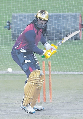 Quetta Gladiators' explosive batsman Chris Gayle eyes a shot during nets under lights at the National Stadium.—AFP