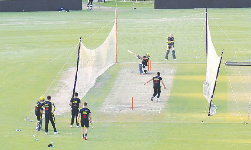 PLAYERS of Lahore Qalandars engaged in a net practice session at the National Stadium on Friday.— Tahir Jamal/White Star