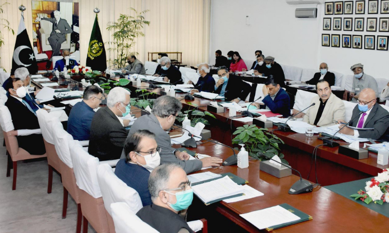 Finance Minister Dr Abdul Hafeez Shaikh presides over a meeting of the Economic Coordination Committee (ECC) of the Cabinet in Islamabad on Friday. — PID