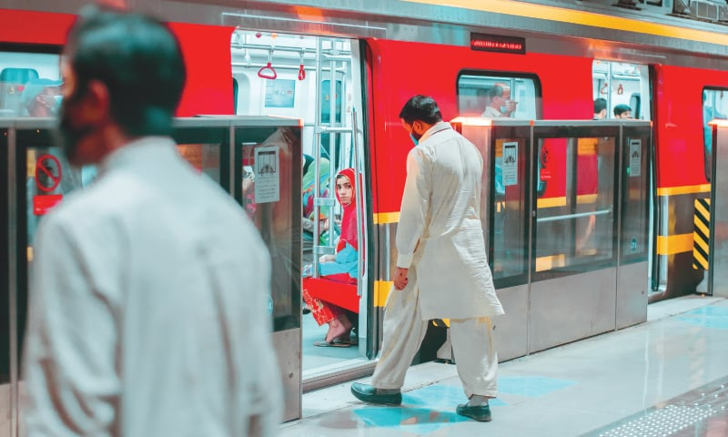 Passengers board the Orange Line Metro Train | Zaroon Ahmad Khan and Abdullah Bajwa