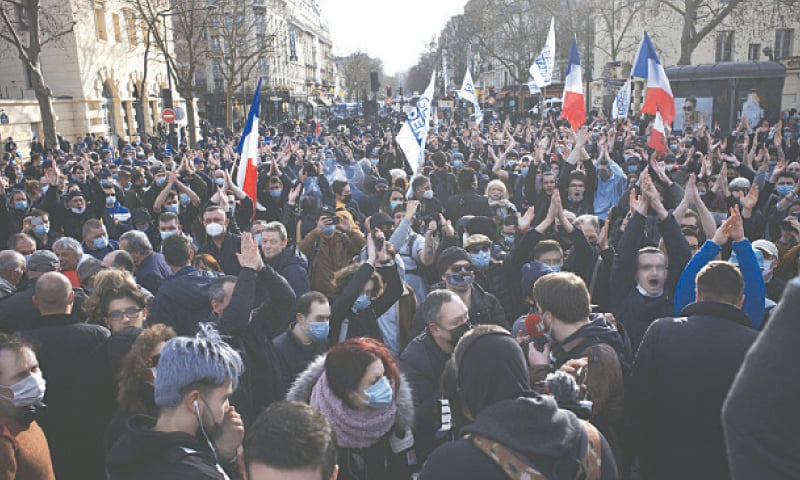 Supporters of anti-migrant movement 'Generation Identity' gather during a demonstration in Paris on Saturday.—AP