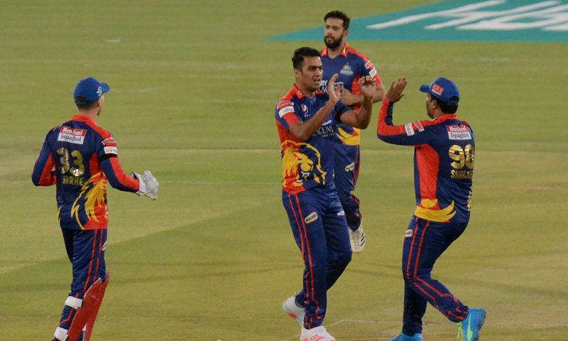 Karachi Kings Arshad Iqbal, centre, celebrates with teammates after taking the wicket of Quetta Gladiators Azam Khan during a Pakistan Super League T20 cricket match between Karachi Kings and Quetta Gladiators at National Stadium, in Karachi, on Saturday. — AP