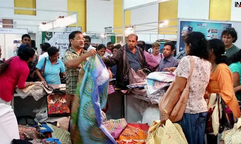 In this file photo, visitors buy cloth at the first three-day exhibition of Pakistani products in Colombo. — INP