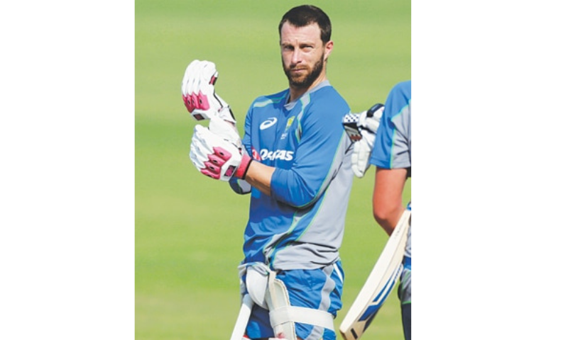 Australian cricketer Matthew Wade pads up during a practice session in Mumbai in this file photo. — AP