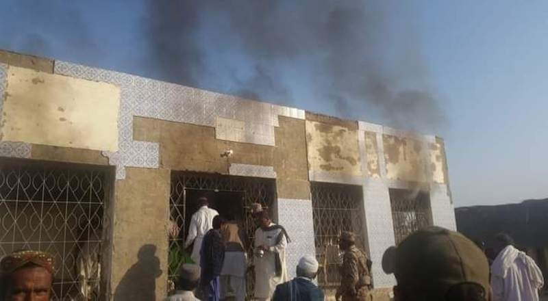 Smoke arises from a polling station in Tharparkar's Chachro tehsil on Sunday where a small fire erupted during the by-polls for district's NA-221 seat. Photo provided by author