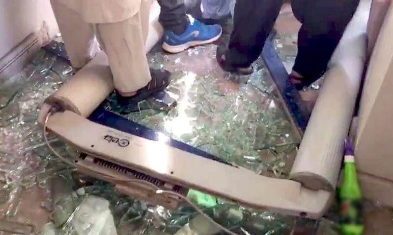 A broken walk-through gate is seen lying on the floor. — DawnNewsTV