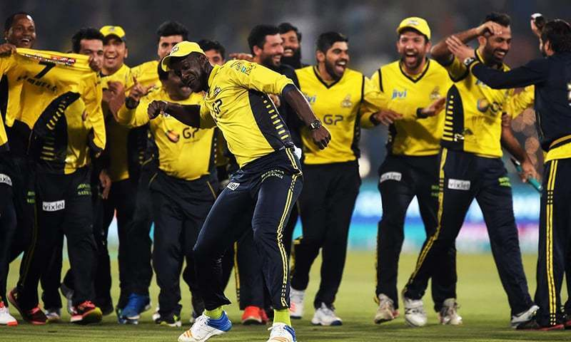 Peshawar Zalmi captain Daren Sammy (C) celebrates with teammates his team's victory over Quetta Gladiators in the final cricket match of the Pakistan Super League (PSL) at The Gaddafi Cricket Stadium in Lahore on March 5, 2017. — AFP/File