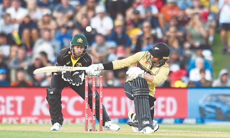 CHRISTCHURCH: New Zealand batsman Devon Conway sweeps past Australian wicket-keeper Matthew Wade during the first Twenty20 International at Hagley Oval on Monday.—AP