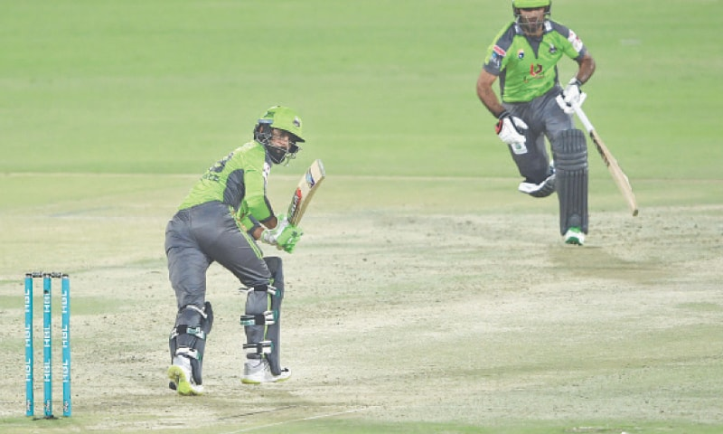 LAHORE Qalandars' batsmen Mohammad Hafeez (left) and Fakhar Zaman run between the wickets during their match against Quetta Gladiators on Monday.—AFP