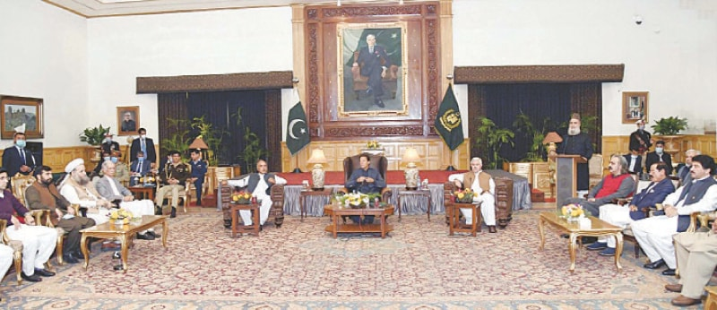 PESHAWAR: Prime Minister Imran Khan exchanging views with PTI parliamentarians during a meeting on Monday.—PPI