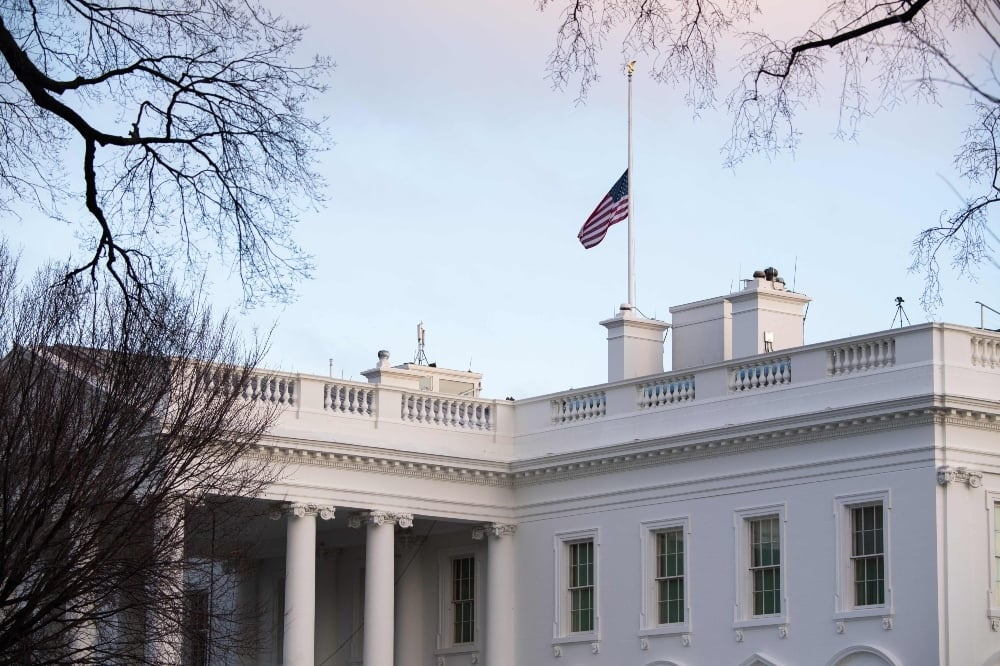 The American flag is seen at half staff over the White House in Washington, DC, February 22, 2021, in honor of the 500,000 lives lost to coronavirus in the United States. —  AFP